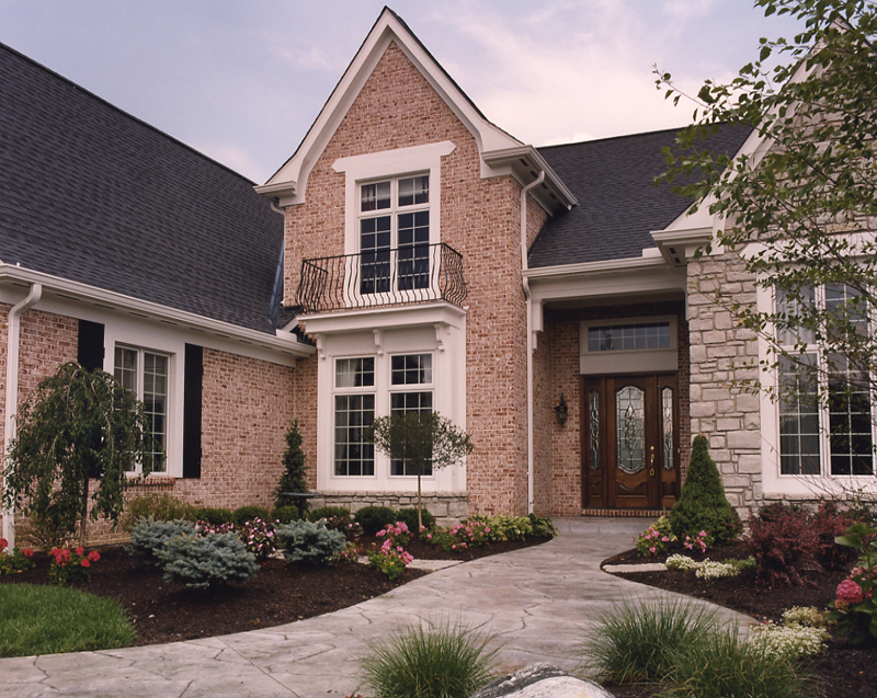 Exterior photos of house plans drawn by studer residential for Brick stone combinations