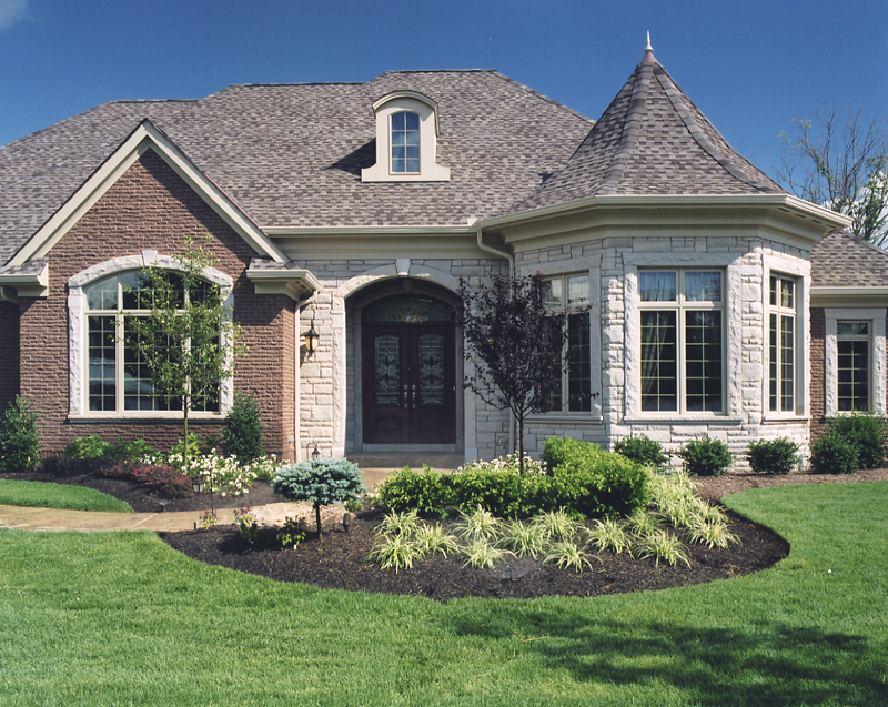 Exterior photos of house plans drawn by studer residential for Stone and brick home designs