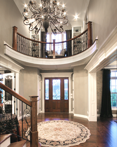 Foyer photos of custom house plans by studer residential for House plans with foyer entrance